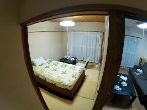 6 Niihama Apt Bed & Livingroom